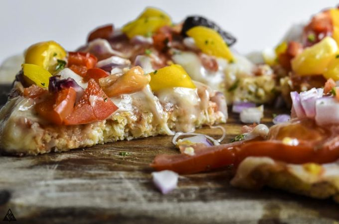 Side view of a slice of cauliflower pizza crust
