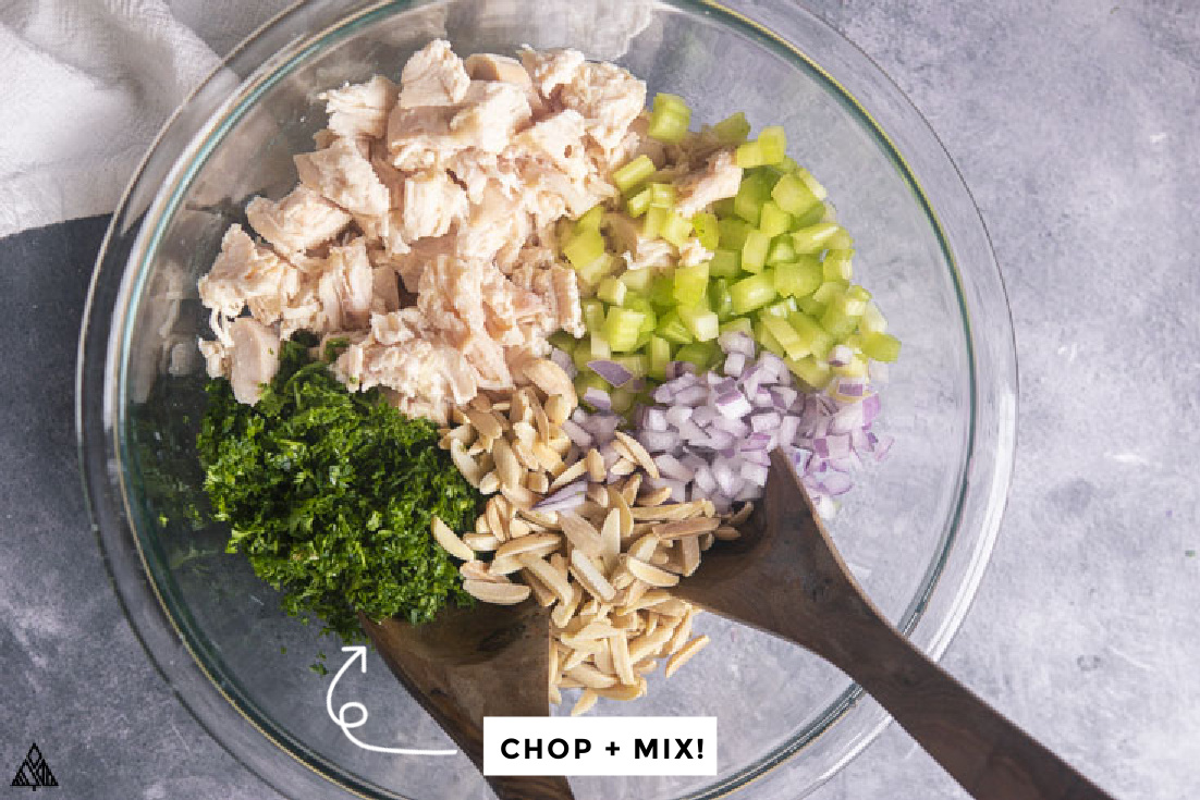 ingredients for chicken salad in a bowl before being mixed