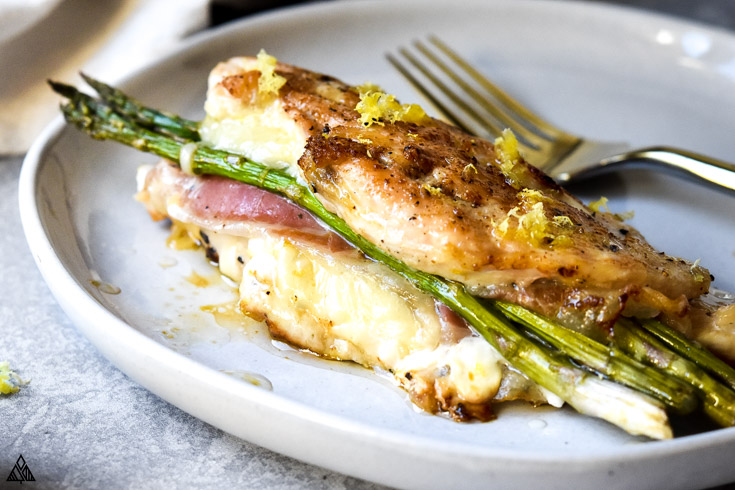 Asparagus stuffed chicken in a plate