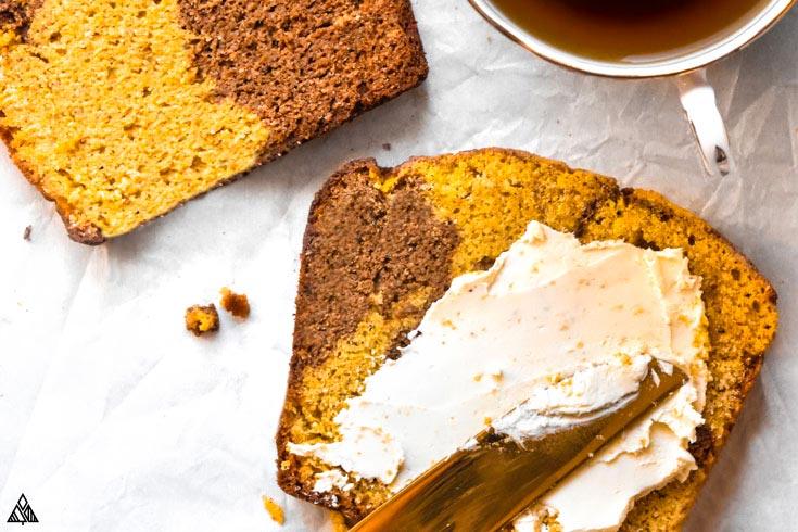 Spreading mayo into a slice of healthy pumpkin bread