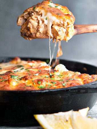 Low carb mexican casserole in a pan and a portion in a ladle