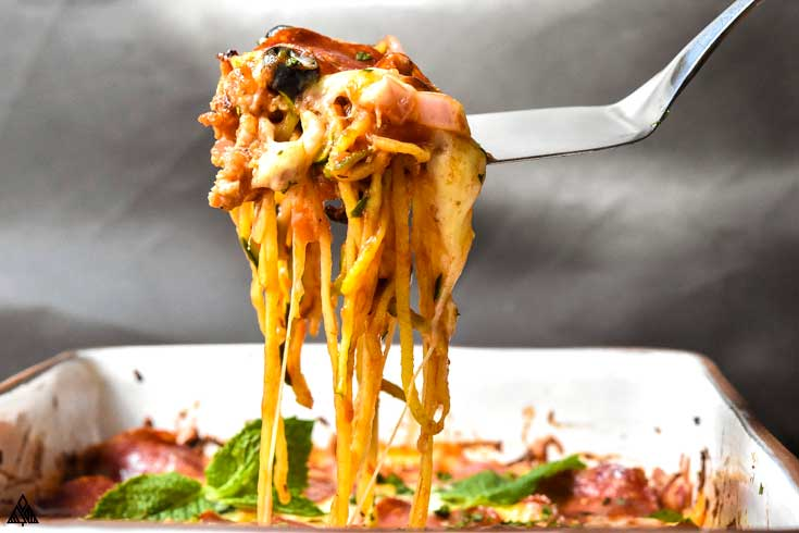 low carb pizza casserole with a fork