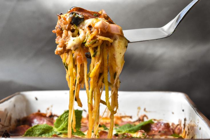 slice of the cheesy keto pizza casserole