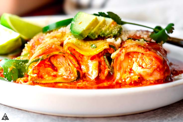 Side view of zucchini enchiladas in a plate