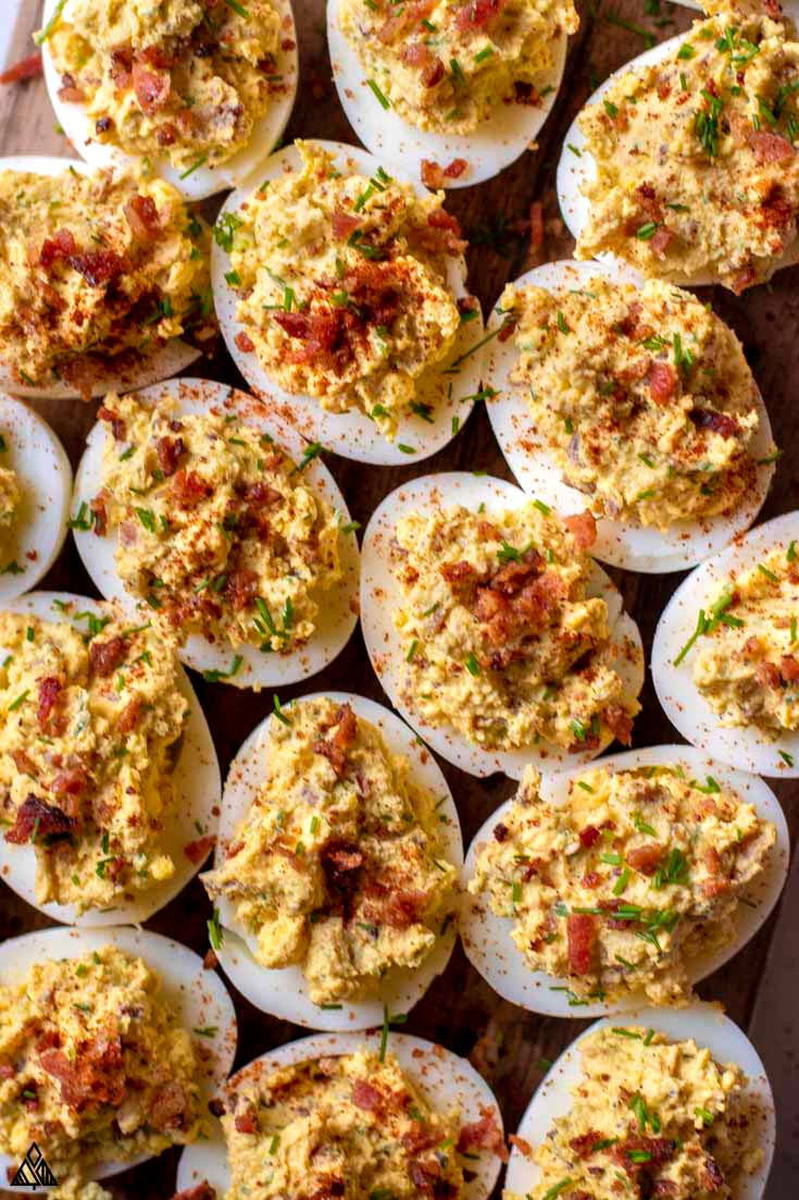 Top view of deviled eggs with bacon