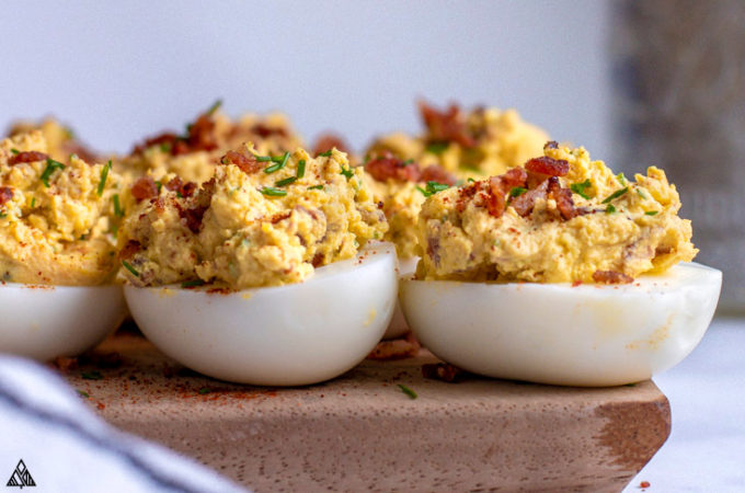 Closer look of deviled eggs with bacon