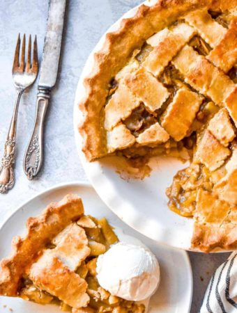 Top view of low carb apple pie and a slice on a plate