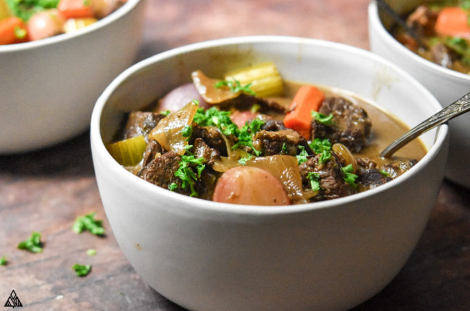 Side view of low carb beef stew in a bowl