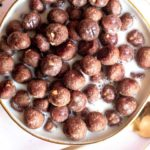 Low carb cocoa puffs in a bowl with milk