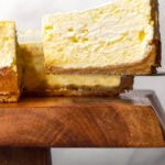 A slice of cheesecake with low carb graham cracker crust