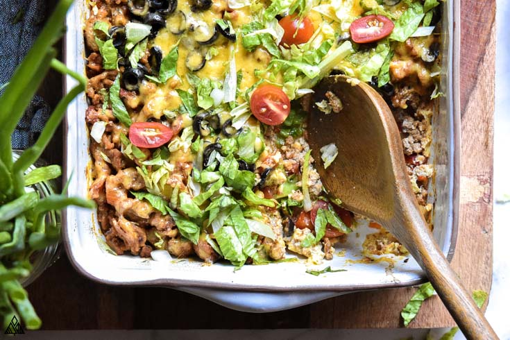 Closer look of low carb taco casserole with a laddle