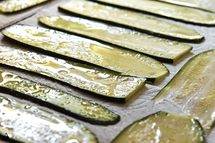 Slices of zucchinis lined in a parchment paper