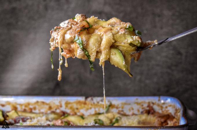 a slice of zucchini lasagna in a ladle