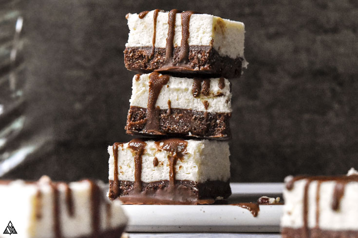 Stack of cheesecake fat bombs and other 2 slices on the side