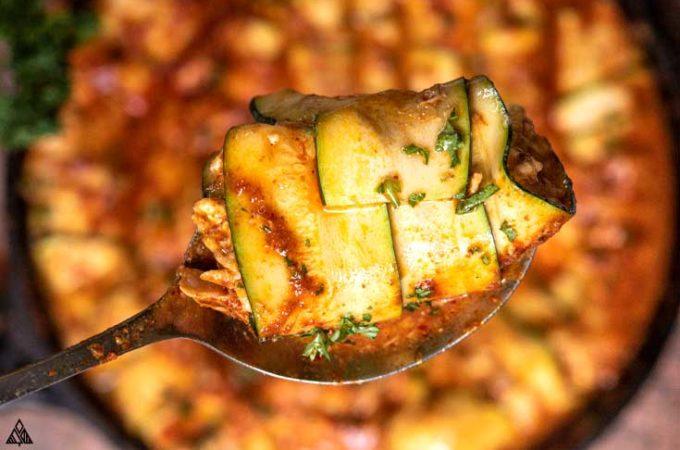 Spoon with zucchini enchiladas