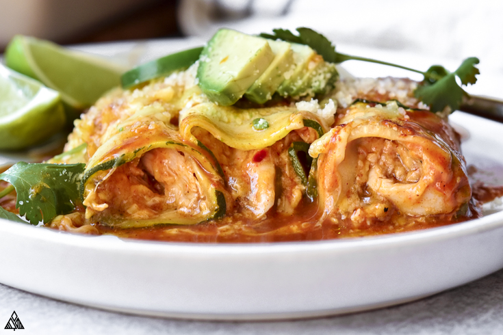 Side view of zucchini enchiladas in plate
