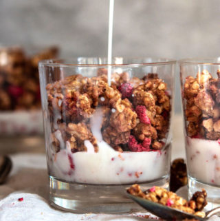 Pouring milk into a glass of low carb granola