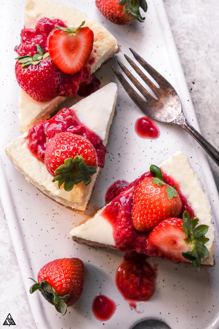 Slices of low carb cheesecake with strawberries on top