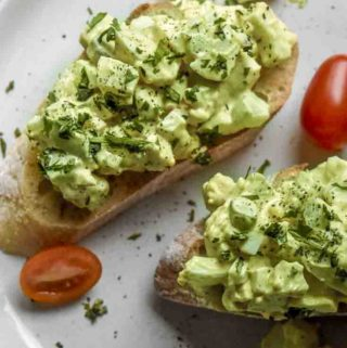 Avocado egg salad on top of 2 slices of bread