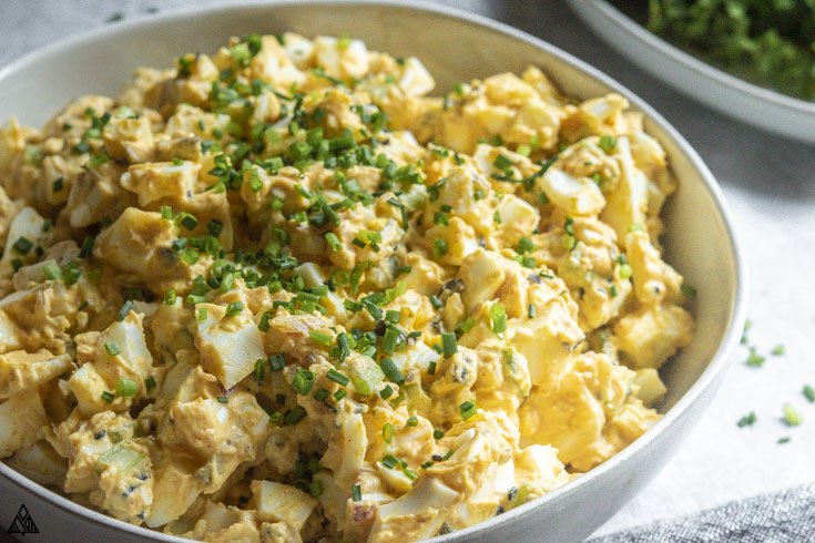 side view of classic egg salad recipe in a bowl