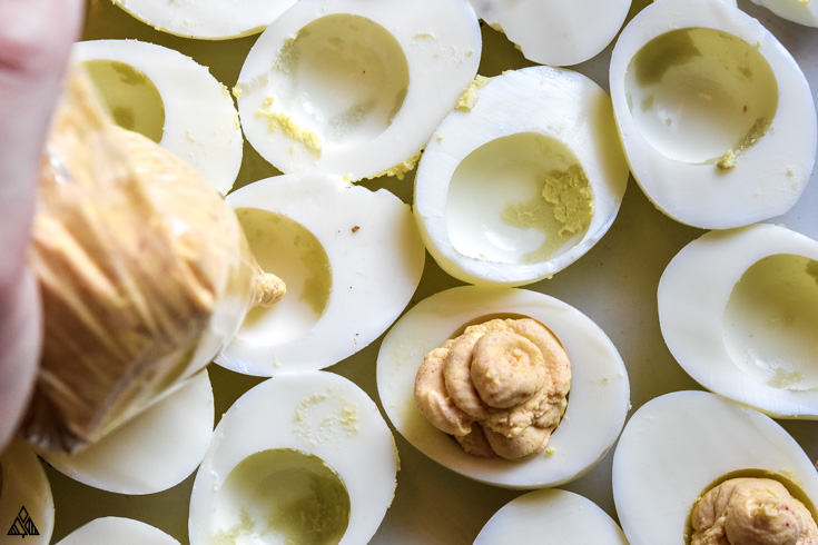Top view of sliced hard boiled eggs without the egg yolks
