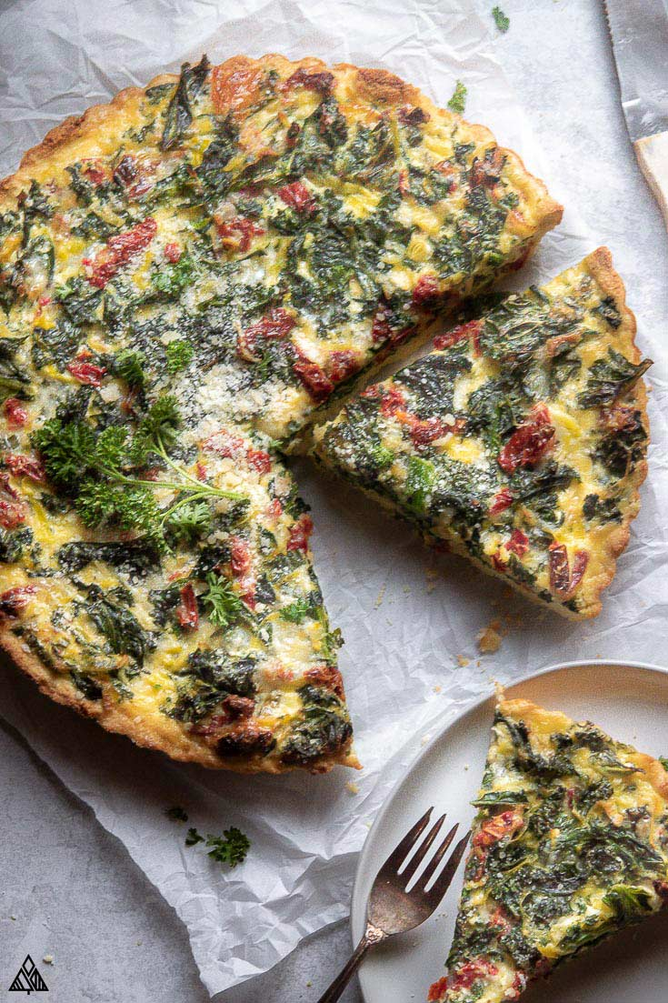 Top view of sliced kale quiche