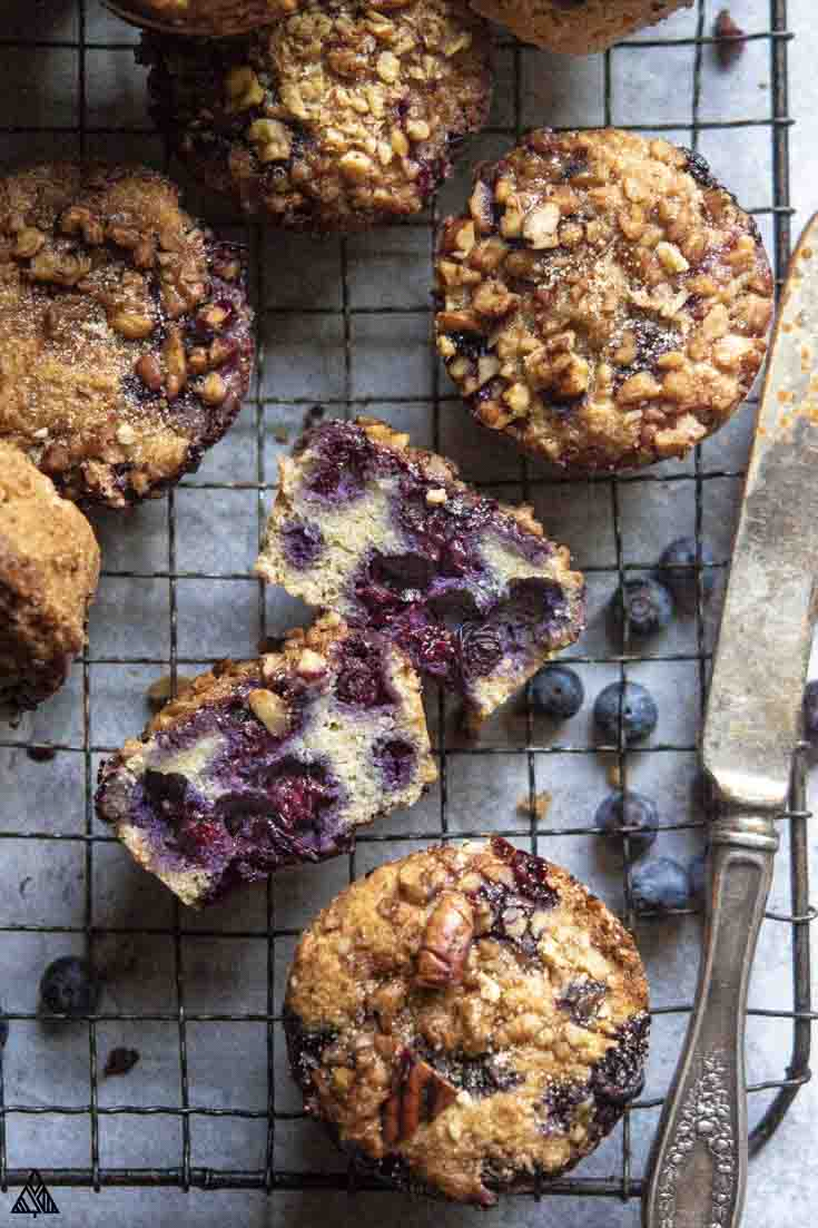Top view of sliced low carb blueberry muffins on a baking screen