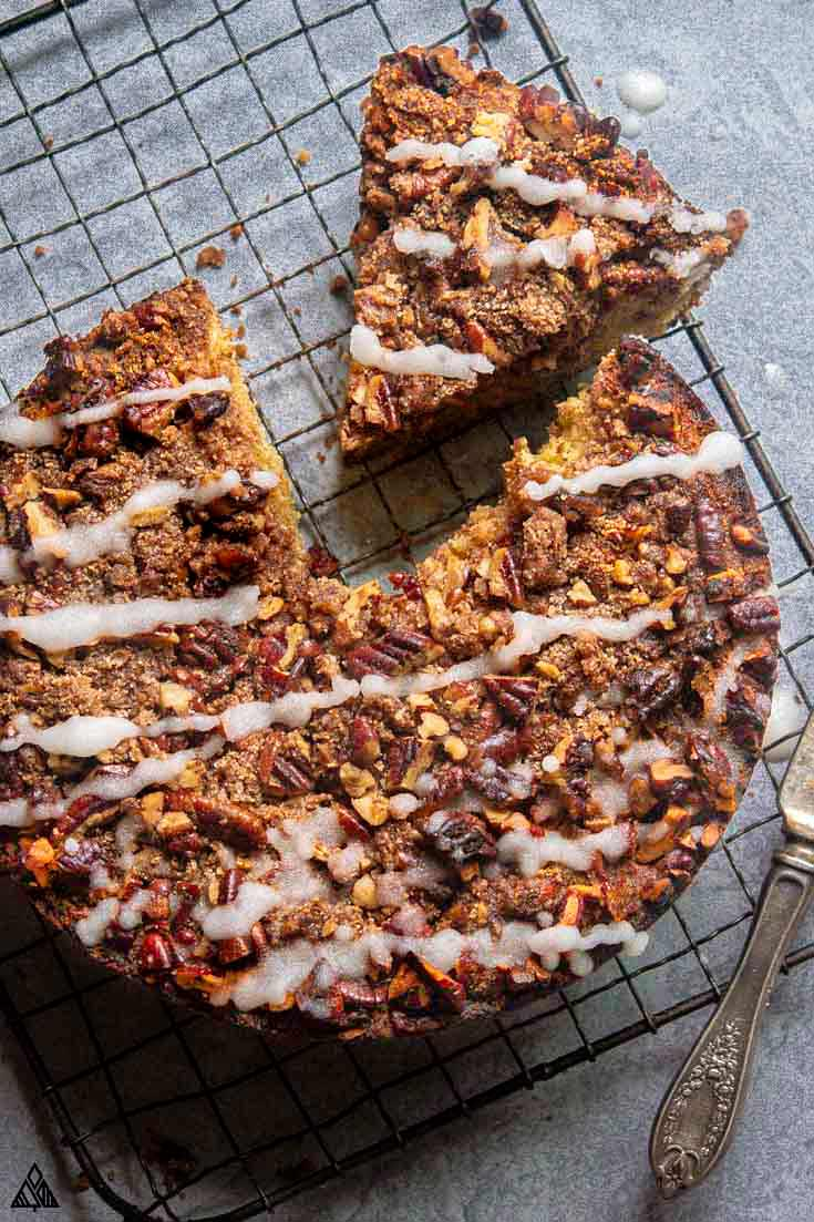 Sliced low carb coffee cake on a baking screen