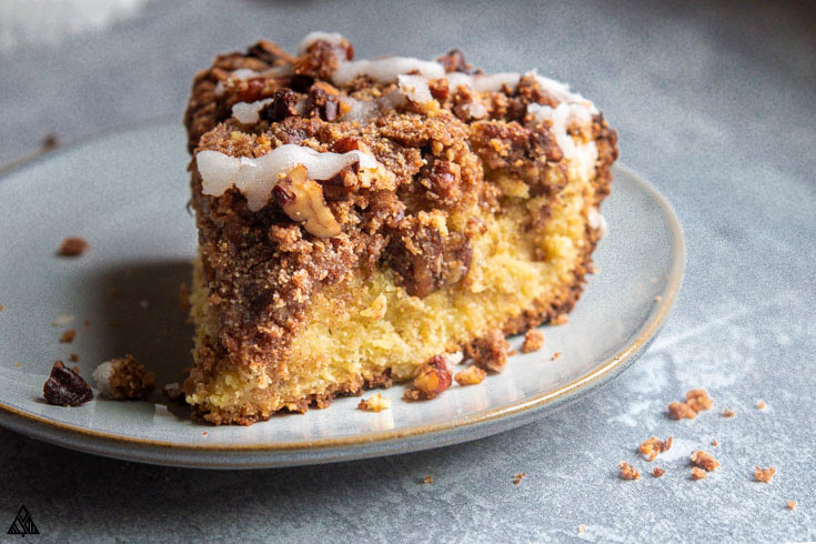A slice of low carb coffee cake on a baking screen