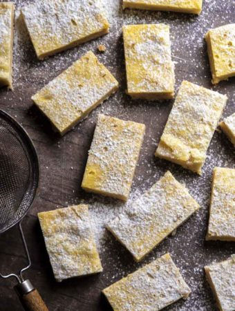 Top view of low carb lemon bars sprinkled with powdered erythritol