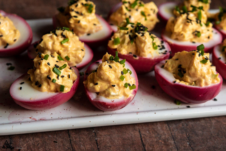 Side view of pickled deviled eggs
