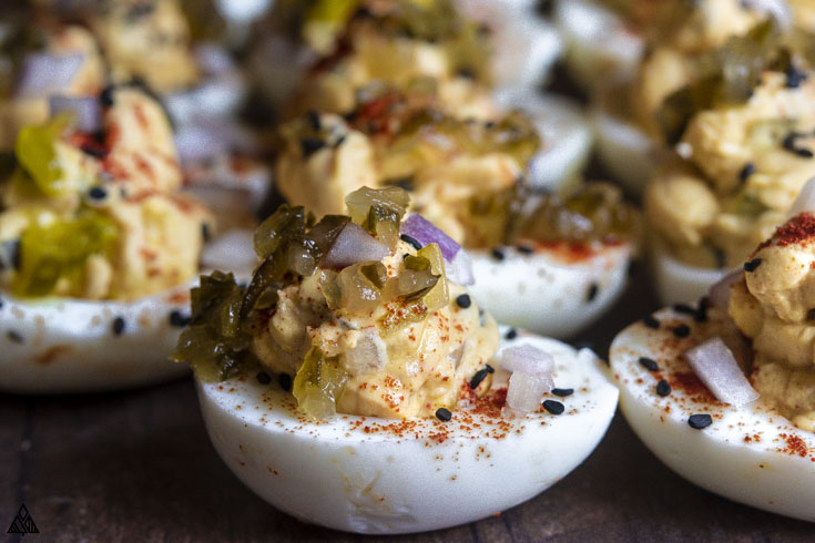 Side view of deviled eggs with relish
