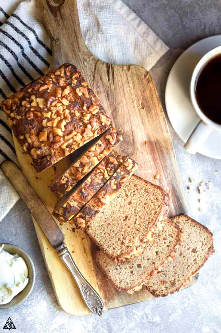 low carb banana bread sliced on a cutting board