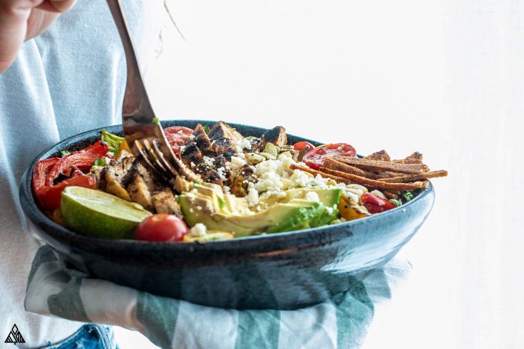 Dipping the fork into a bowl of low carb taco salad