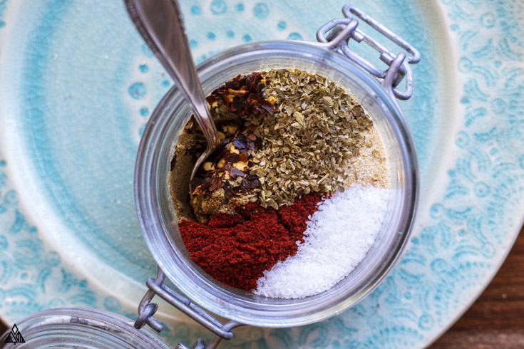 All the ingredients for low carb taco seasoning in a small jar