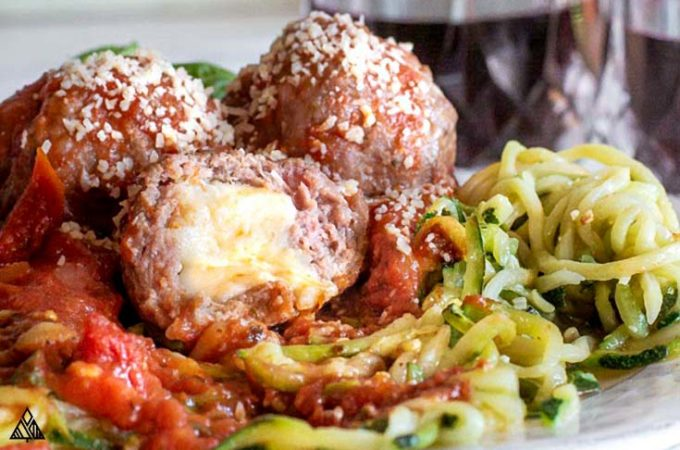 cheese oozing out of mozzarella stuffed meatballs