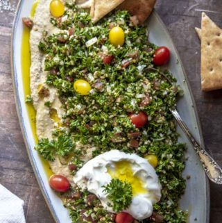 Tabouleh in a plate with egg and slices of bread