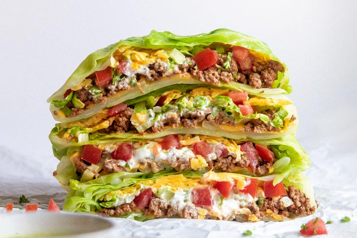 Closer look of a stack of low carb crunchwrap supreme