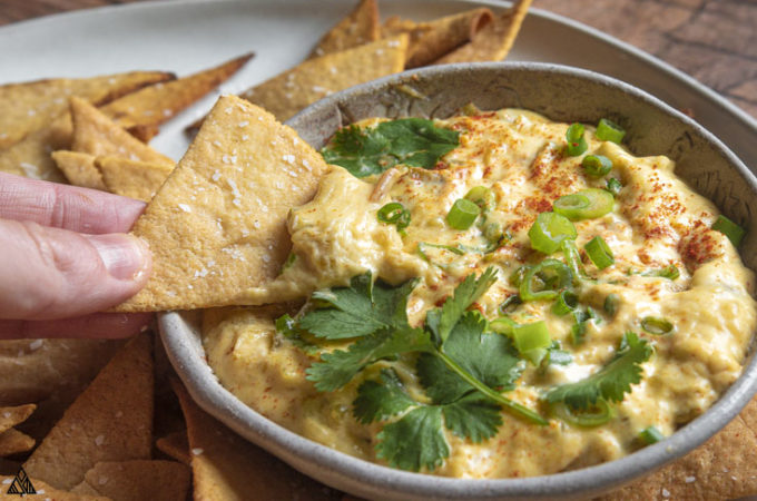 Side view of low carb queso with dipped chips