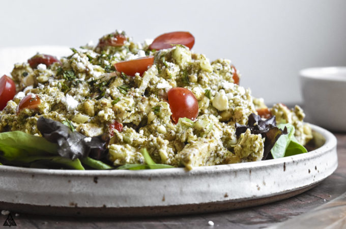 Side view of pesto chicken salad in a plate