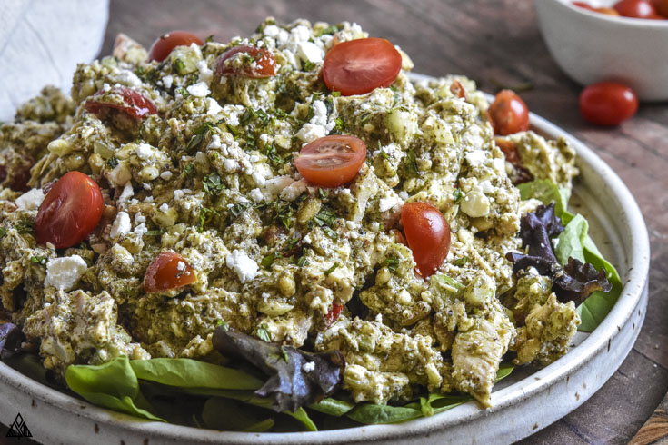 Closer look of pesto chicken salad in a plate