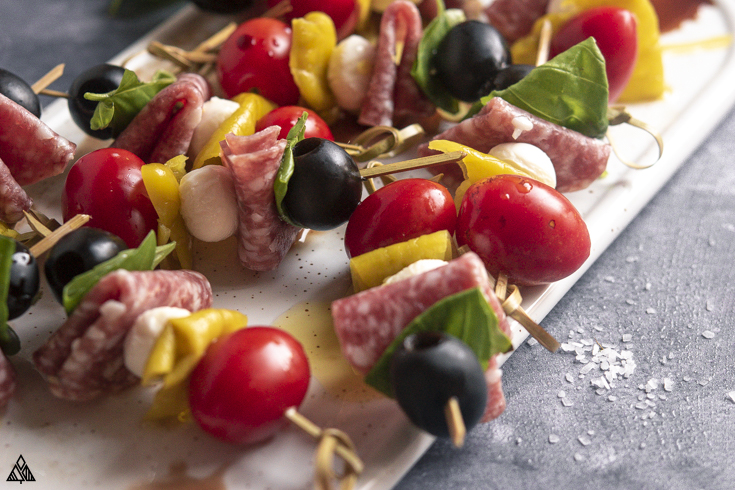 Closer look of antipasto skewers on a cutting board