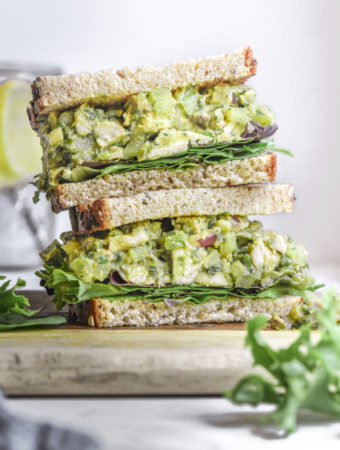 stack of avocado chicken salad sandwiches