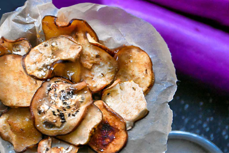 low carb chips made from eggplants with eggplant in background