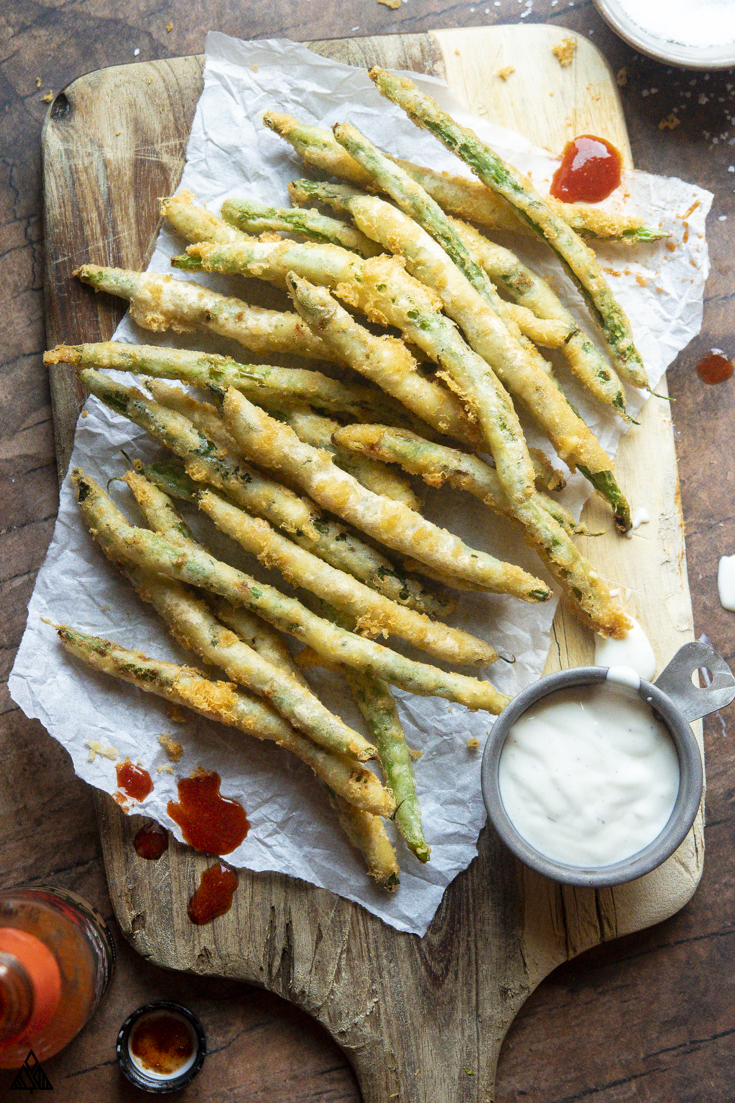 Low carb fried green beans on a parchment paper