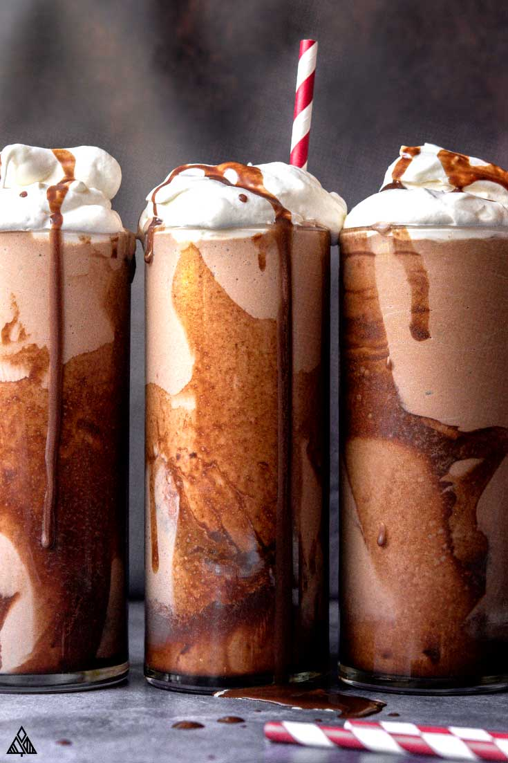 three keto milkshakes with whipped cream