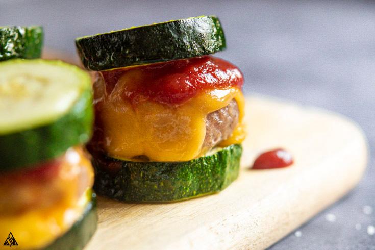 Closer look of turkey burger sliders on a cutting board