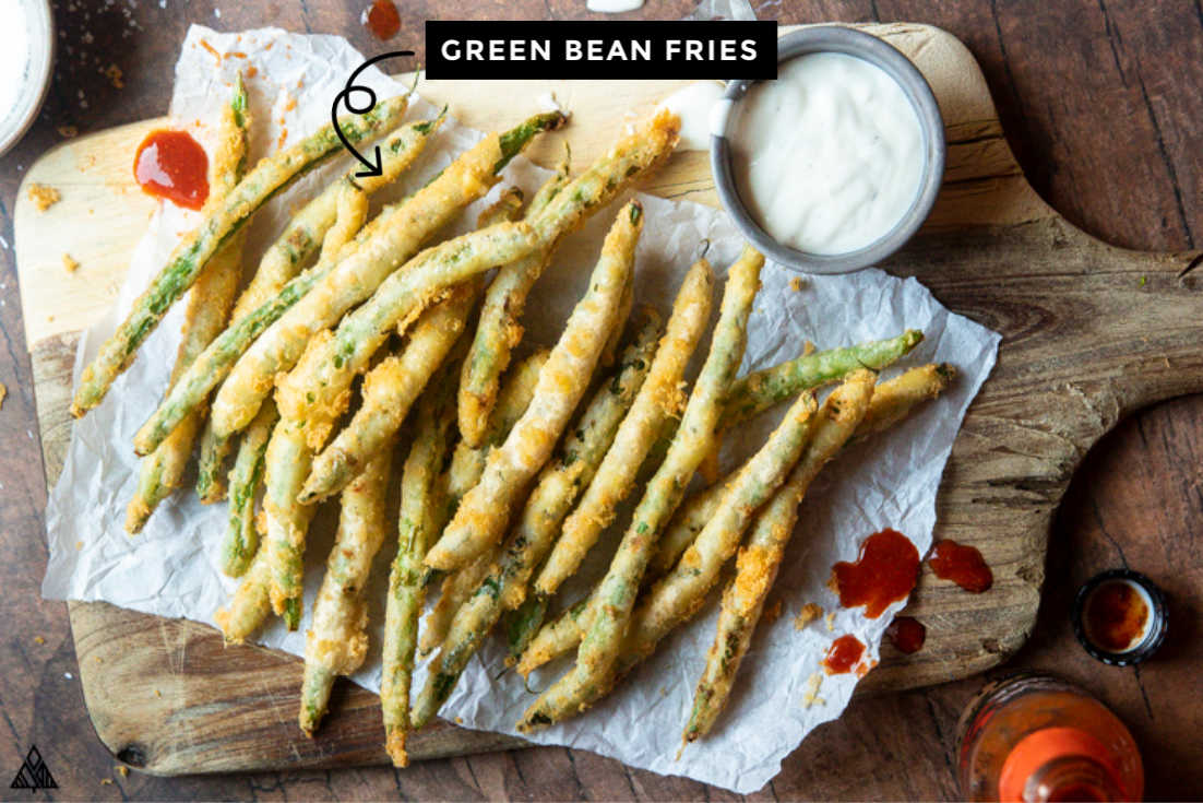 Green bean fries on a parchment paper