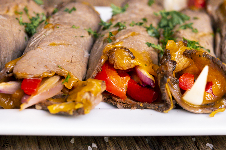 Roast beef roll ups in a plate