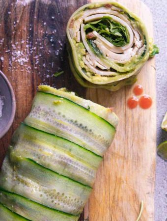 sliced cucumber wraps on a wooden board